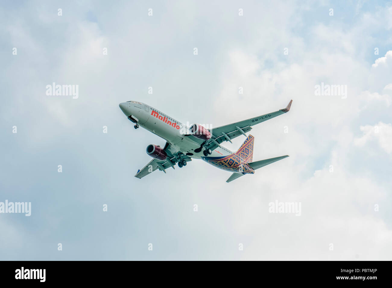 Singapore - June 03 2018: Airliner on final approach into Changi Airport - Stock Image