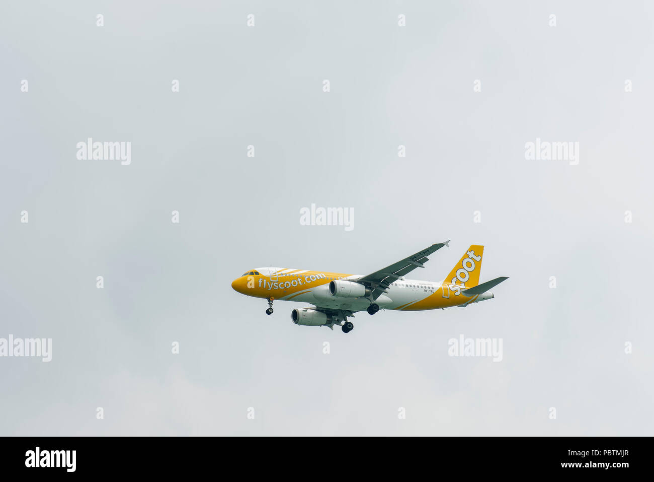Singapore - June 03 2018: Airliner on final Approach into Changi Airport. - Stock Image