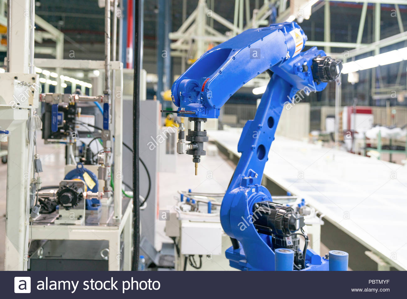 robotic hand machine tool at industrial manufacture factory - Stock Image