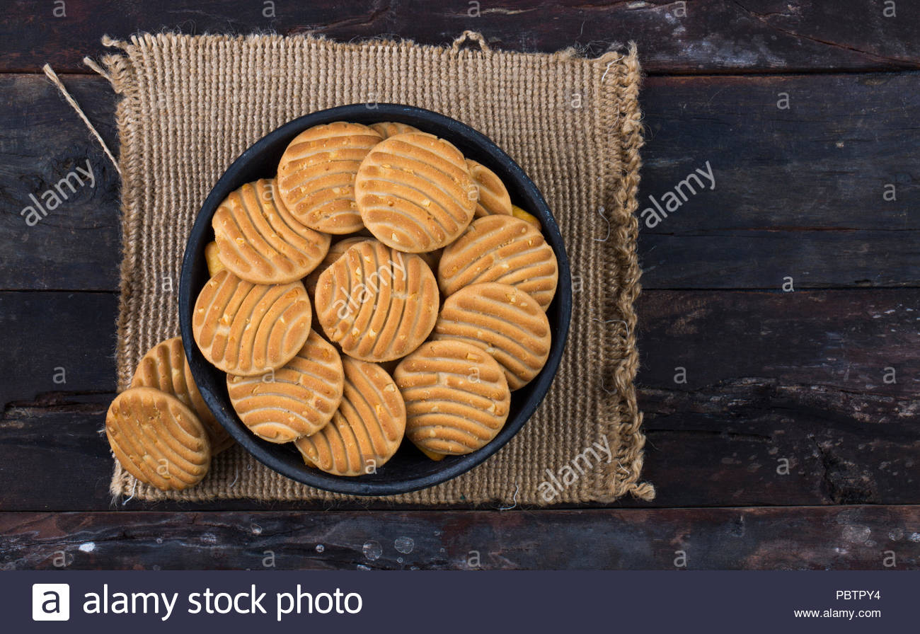 Biscuit sweet cookie background. Domestic stacked butter biscuit pattern concept - Stock Image