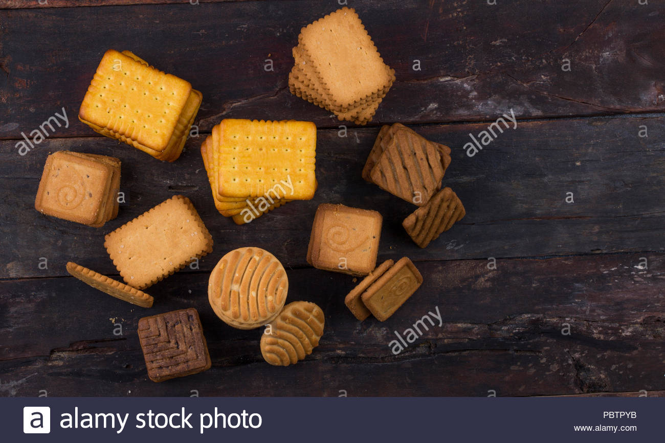 Biscuit sweet cookie background. Domestic stacked butter biscuit pattern concept Stock Photo