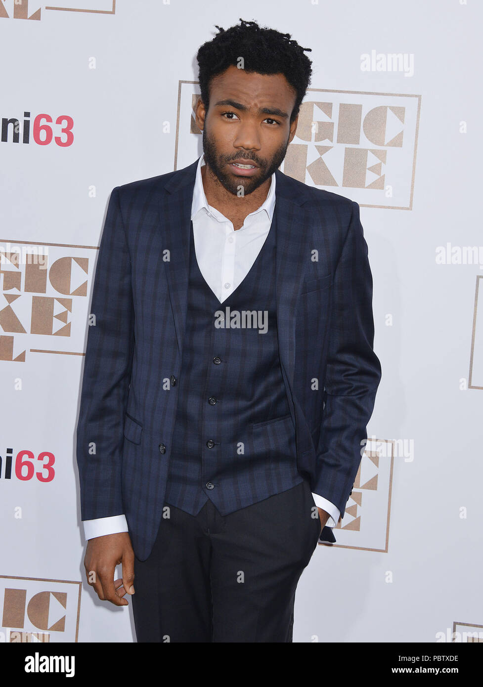 Donald Glover  at the Magic Mike XXL premiere at the TCL Chinese Theatre in Los Angeles. June 25, 2015.Donald Glover  ------------- Red Carpet Event, Vertical, USA, Film Industry, Celebrities,  Photography, Bestof, Arts Culture and Entertainment, Topix Celebrities fashion /  Vertical, Best of, Event in Hollywood Life - California,  Red Carpet and backstage, USA, Film Industry, Celebrities,  movie celebrities, TV celebrities, Music celebrities, Photography, Bestof, Arts Culture and Entertainment,  Topix, Three Quarters, vertical, one person,, from the year , 2015, inquiry tsuni@Gamma-USA.com - Stock Image