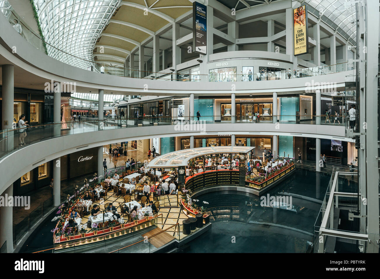 Luxury cafe interior in Marina Bay Sands shopping mall. Singapore - Stock Image