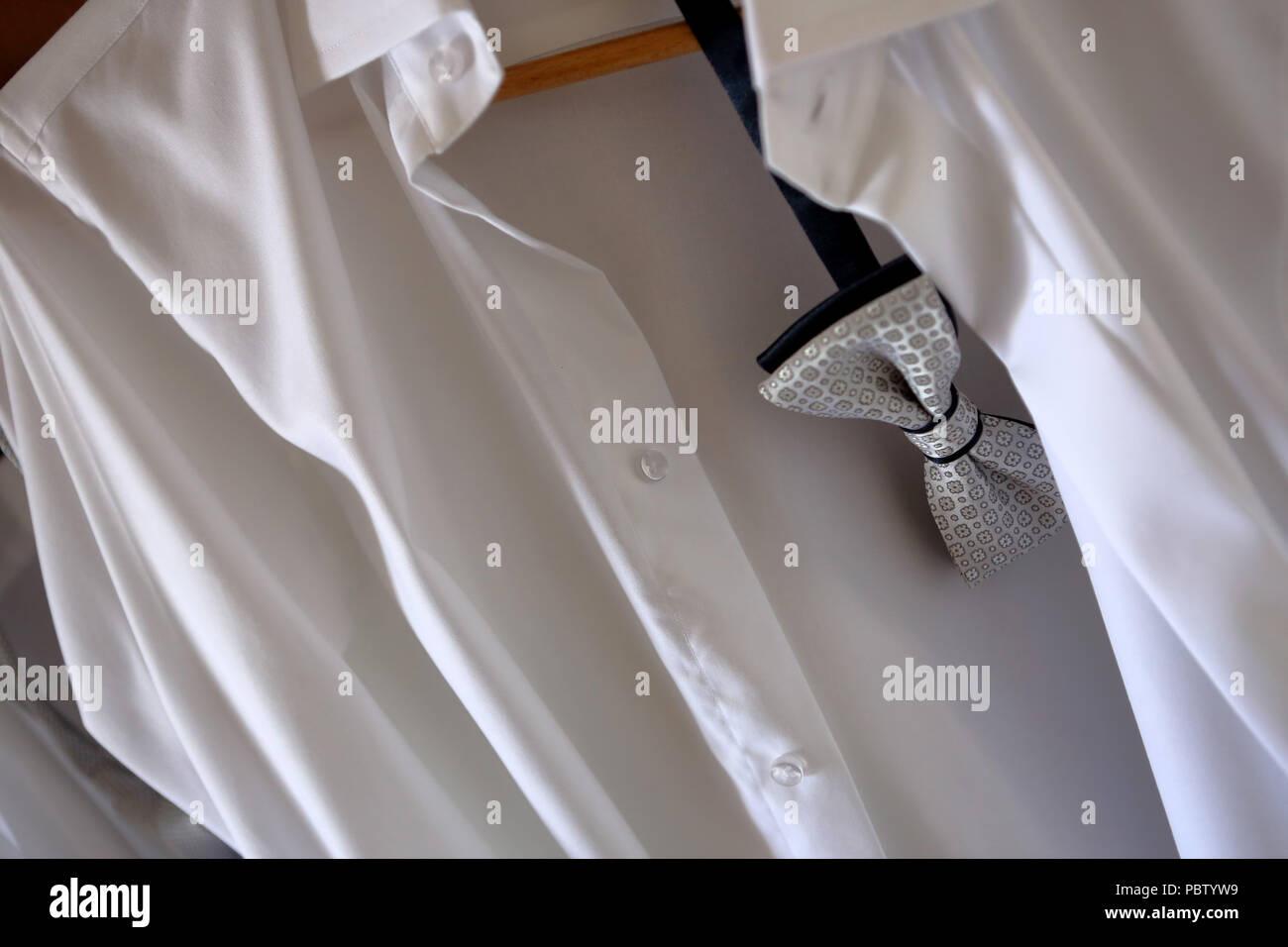 01ea1e4d2b57 Groom's shirt and bow tie ready to wear Stock Photo: 213834357 - Alamy