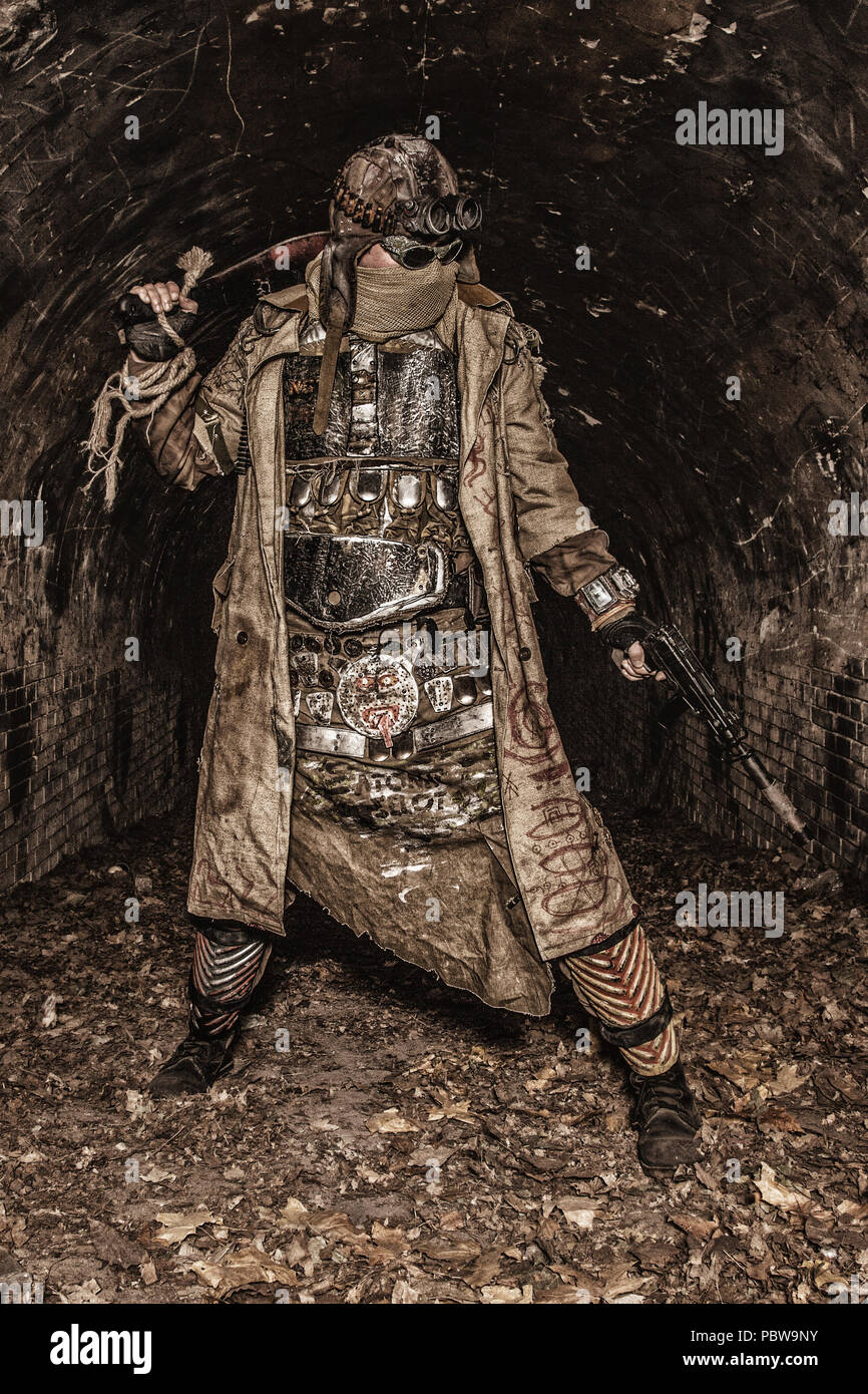 Post apocalyptic survivor in abandoned tunnel - Stock Image