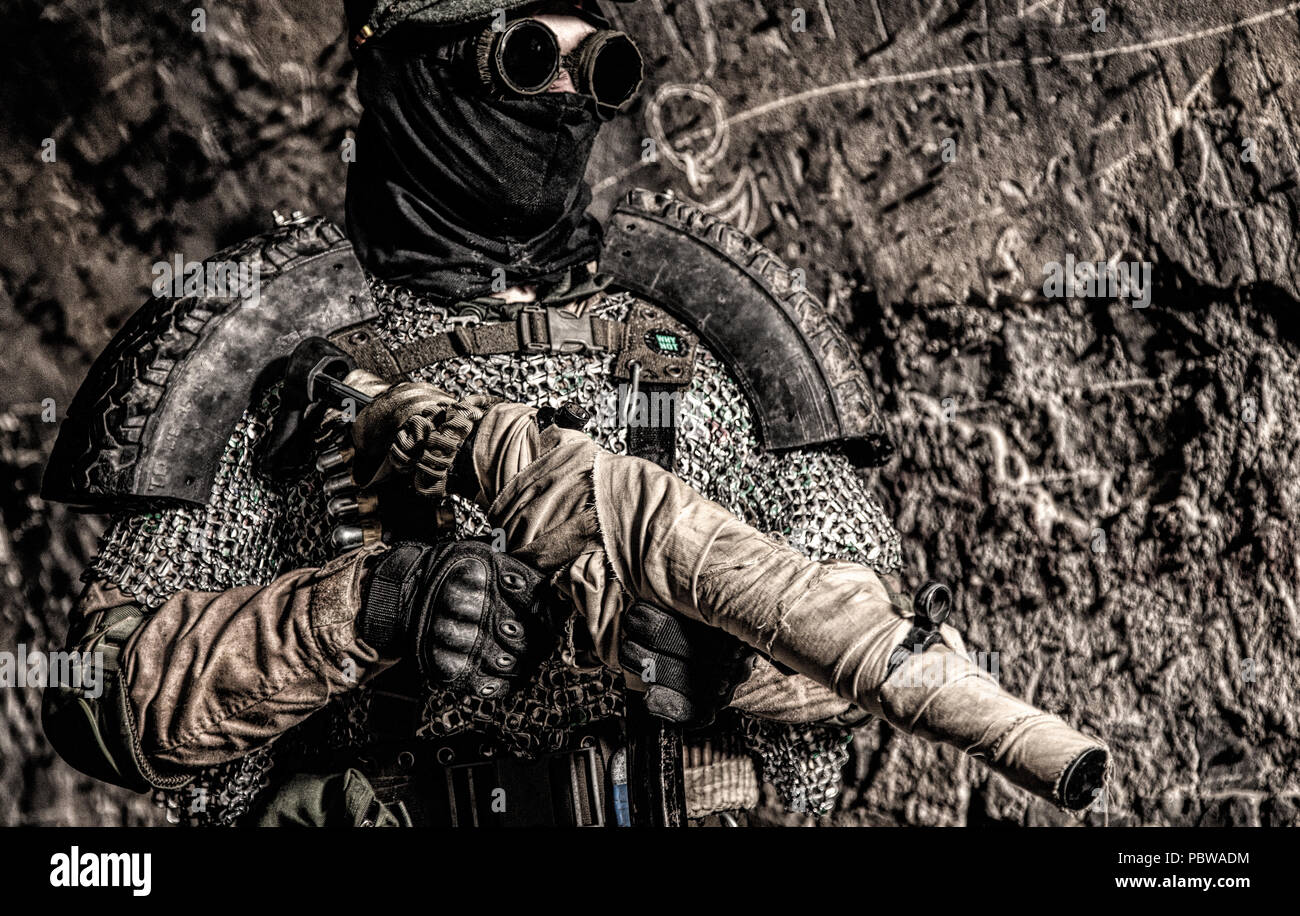 Post apocalypse soldier aiming with handmade gun - Stock Image