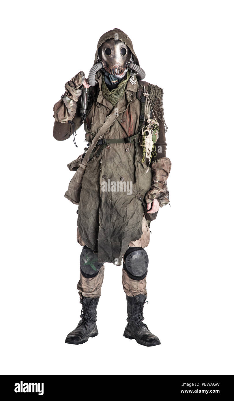 Post apocalyptic survivor in gas mask and rags - Stock Image