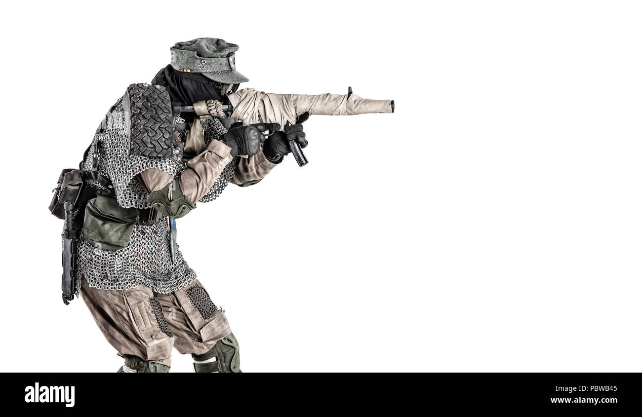 Post apocalyptic soldier aiming firearm weapon - Stock Image