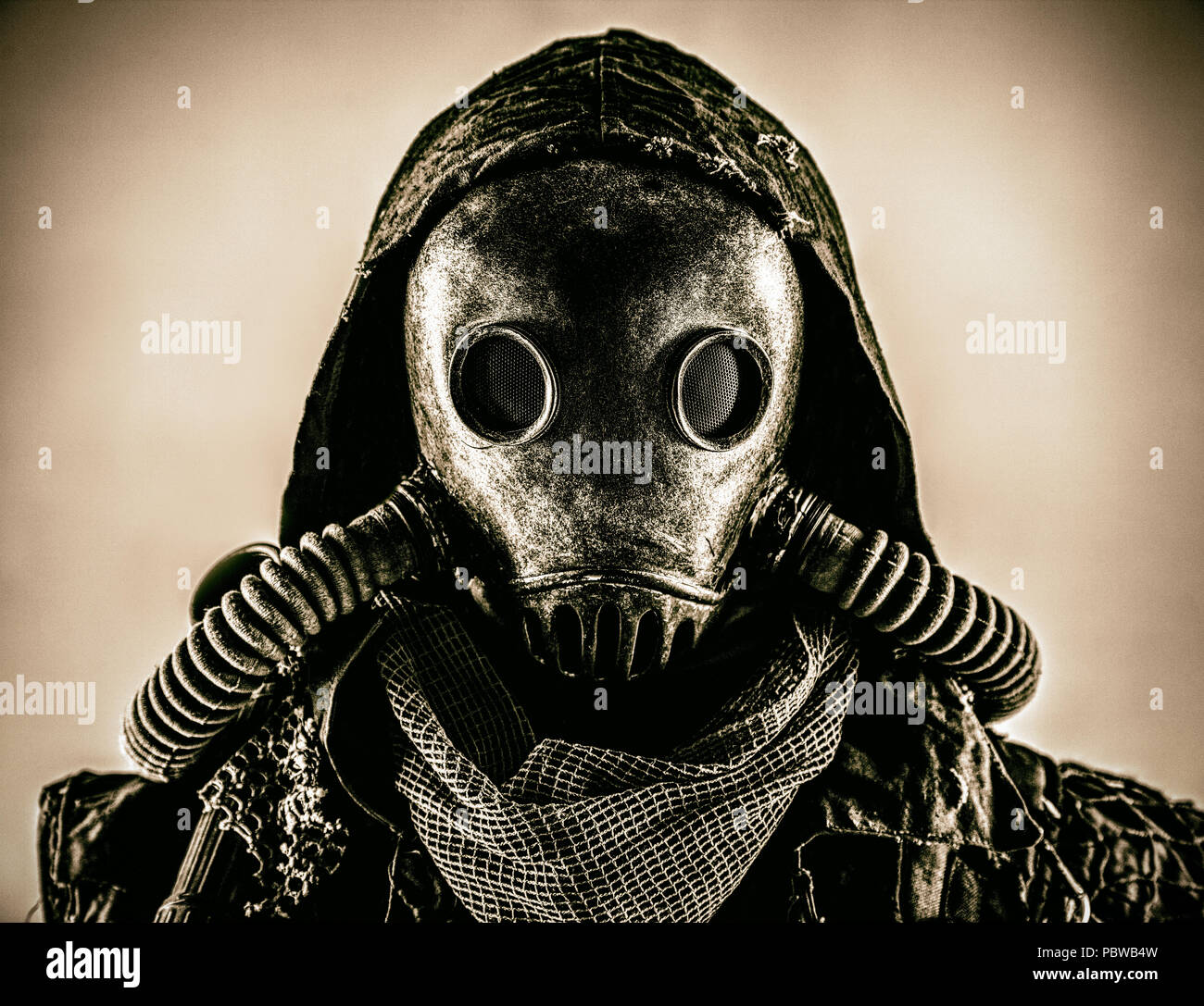 Portrait of post apocalyptic survivor in gas mask - Stock Image