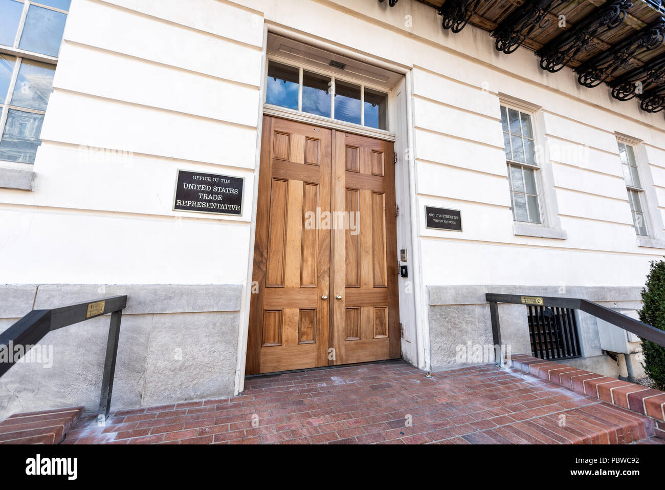 Washington DC, USA - March 9, 2018: United States Trade Representative visitor entrance wooden door and sign for office - Stock Image