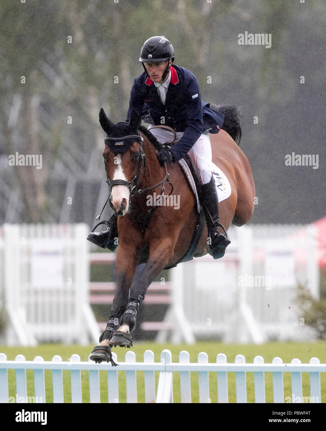 Hickstead(Britain. 30th July, 2018. William Whitaker of Britain competes during the Longines FEI Jumping Nations Cup in Hickstead, Britain on July 29, 2018. Credit: Han Yan/Xinhua/Alamy Live News Stock Photo