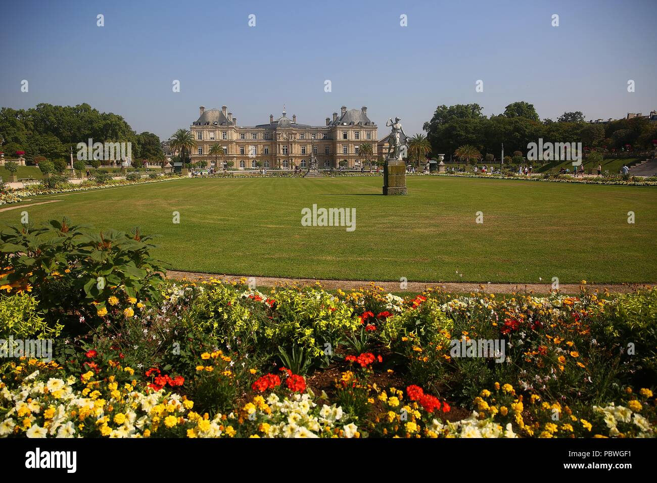 July 23, 2018 - Paris, France - The Luxembourg Gardens in Paris, France.  The Gardens were created beginning in 1612 by Marie de' Medici, the widow of King Henry IV of France, for a new residence she constructed, the Luxembourg Palace.  It covers 23 hectares and is known for its lawns, tree-lined promenades, flowerbeds, model sailboats on its circular basin, and picturesque Medici Fountain, built in 1620. (Credit Image: © Leigh Taylor via ZUMA Wire) - Stock Image