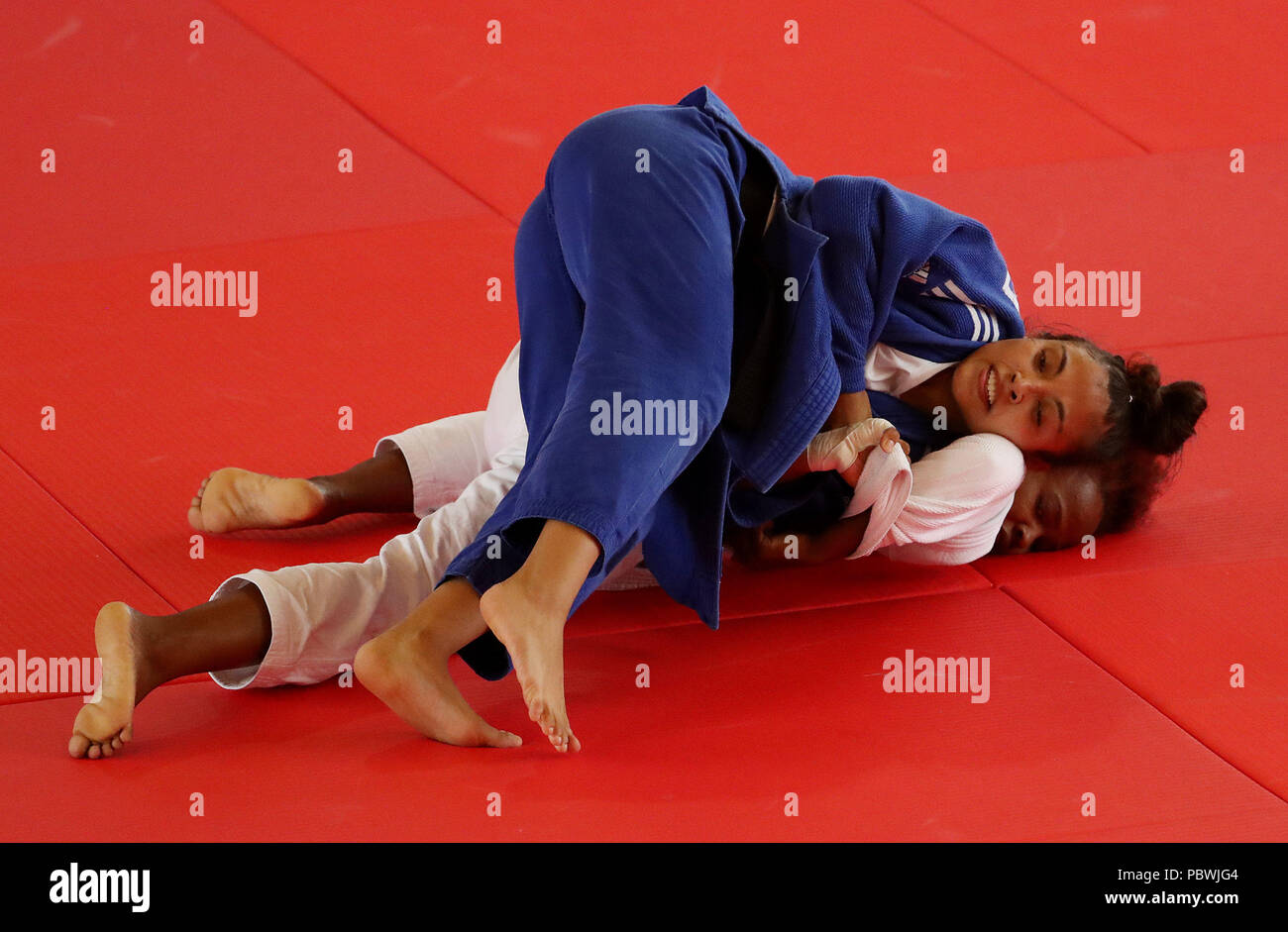 Barranquilla, Colombia. 30th July, 2018. Dominican Diana de Jesus (down) in action against Mexican Luz Olivera during the judo competition of the 23rd Central American and Caribbean Games 2018, in Barranquilla, Colombia, 30 July 2018. Credit: Leonardo Munoz/EFE/Alamy Live News - Stock Image