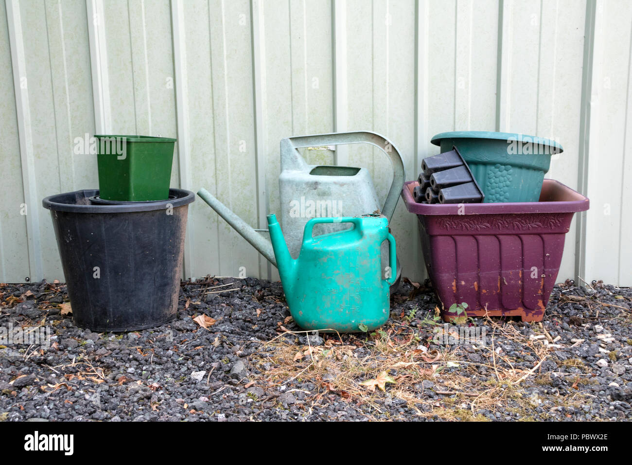 Discarded plastic gardening items. - Stock Image