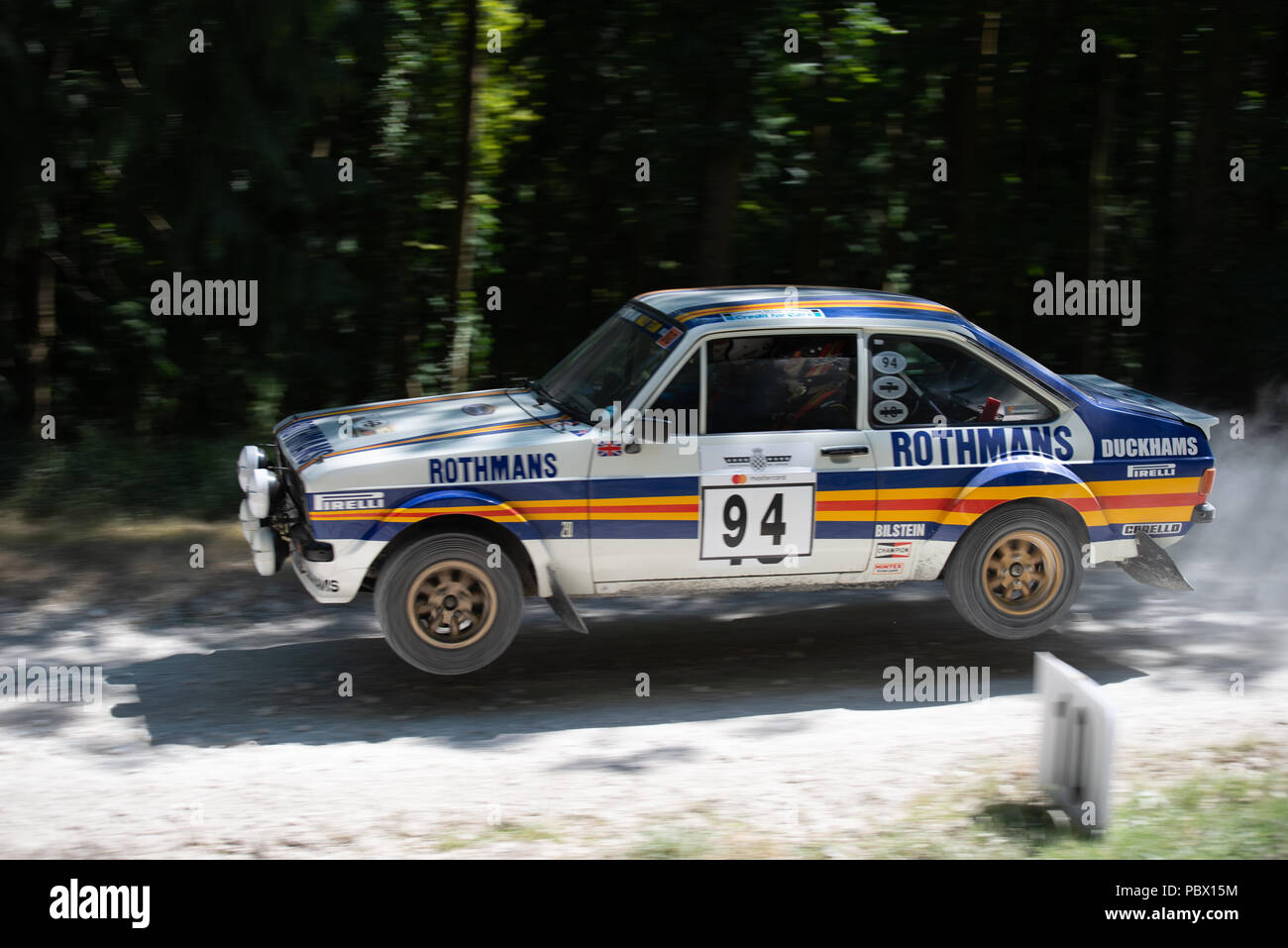 a ford escort rs1800 mk2 takes to the air as it leaps from the jump in