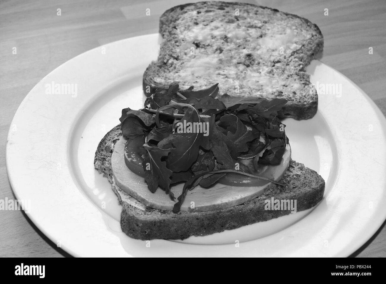 ham sandwich on whole grain brown bread - Stock Image