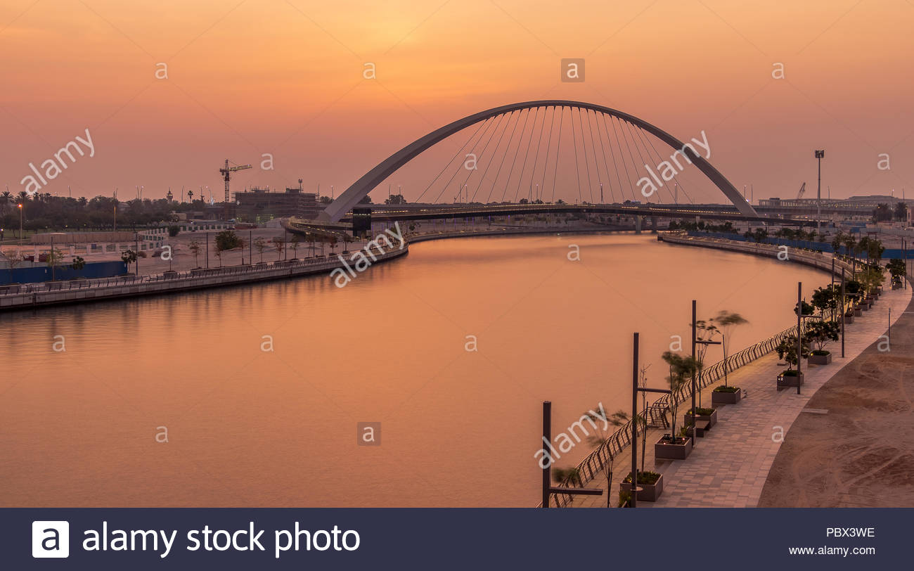 Panoramic View of the Tolerance Bridge at the Dubai Water Canal during Sunset. - Stock Image