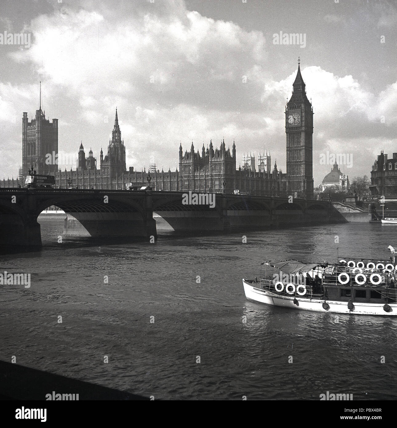 1950s, view of Westminster Bridge and the Palace of Westminster, more commonly known as the Houses of Parliament, London, England, UK. Stock Photo