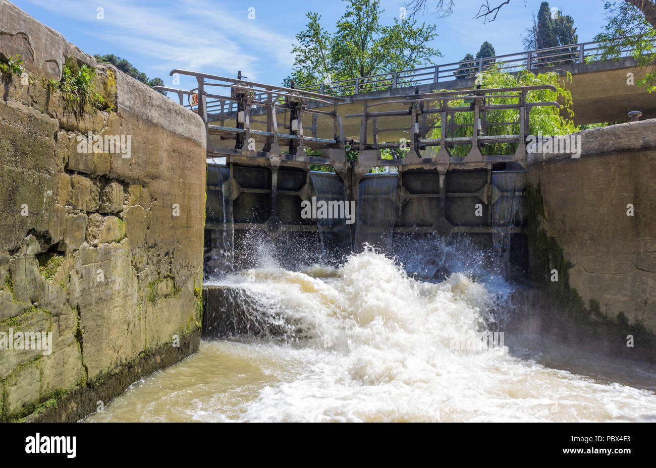 Canal du Midi, Carcassonne, French department of Aude, Occitanie Region, France. Lock gates opening on the canal. A lock is a device used for raising  - Stock Image