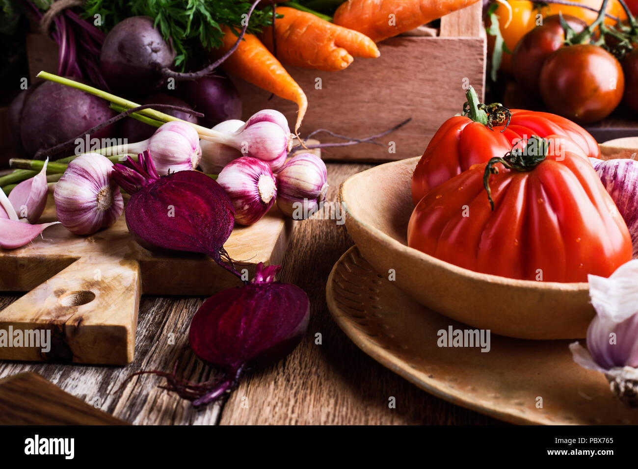 Fresh organic homegrown colofrul vegetables on wooden rustic table, harvest time - Stock Image