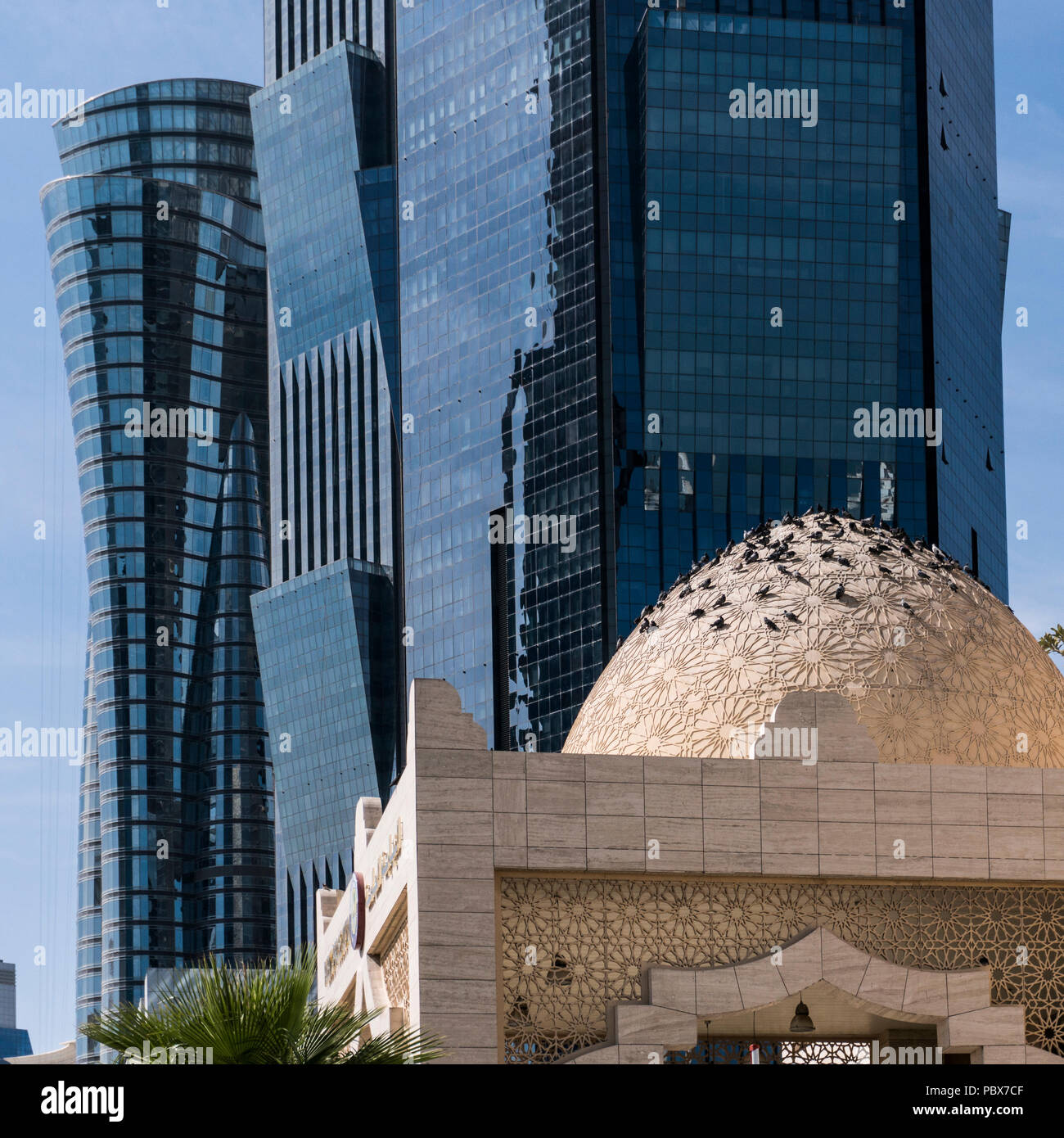 DOHA, QATAR - FEB 2018: Compilation of Mosque Dome and Modern Blue High Skyscrapers in Doha city, Qatar. - Stock Image