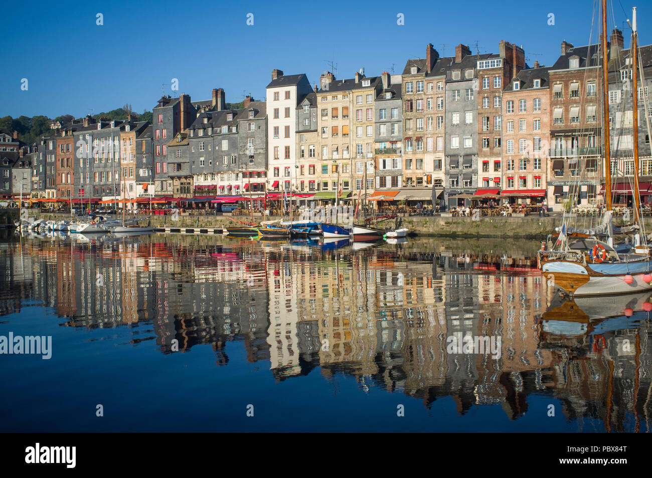The harbour or Vieux Bassin in Honfleur at dawn, Normandy, France Stock Photo