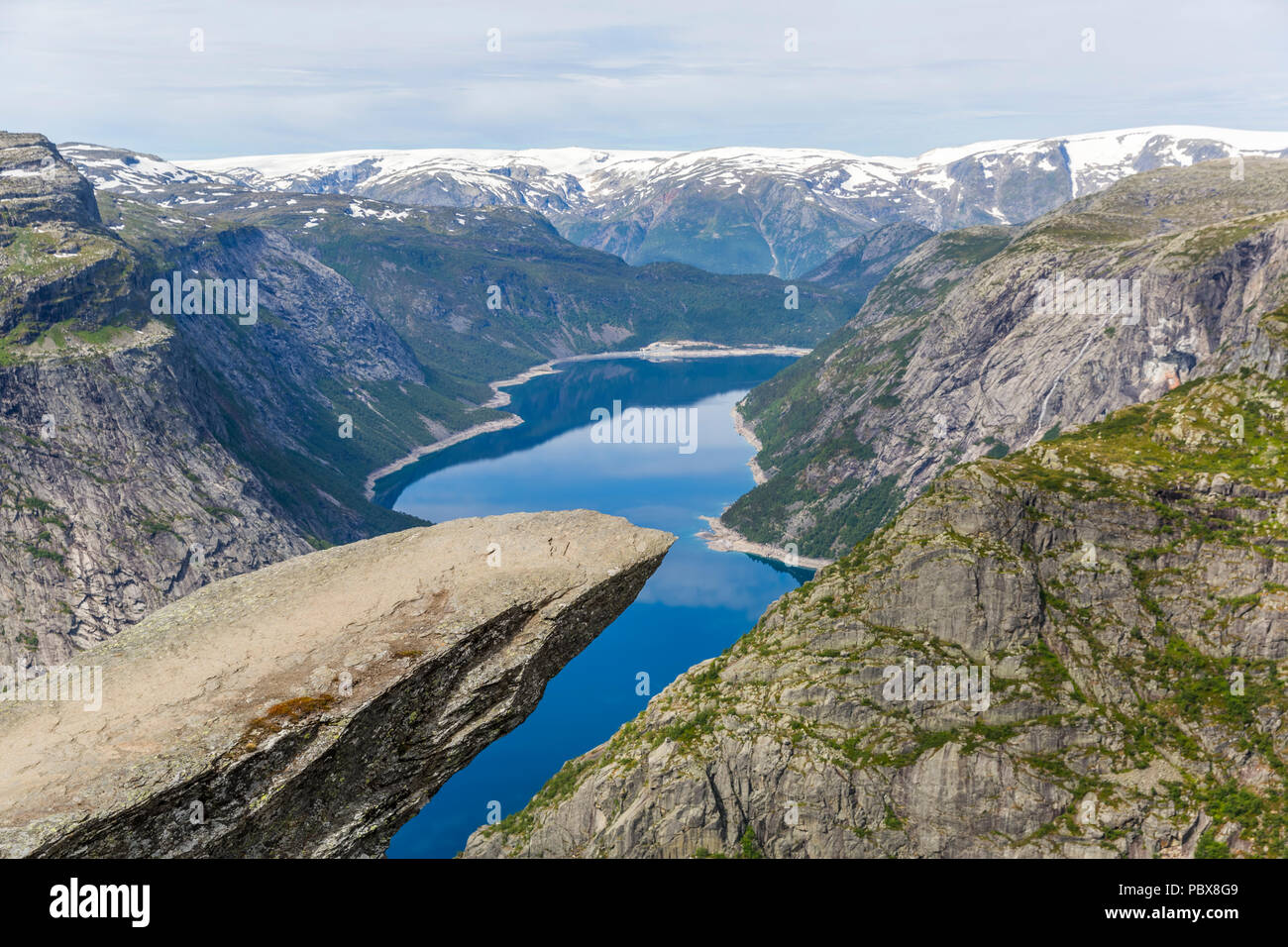 Trolltunga rock formation is one of the most popular and scenic places in Norway - Stock Image