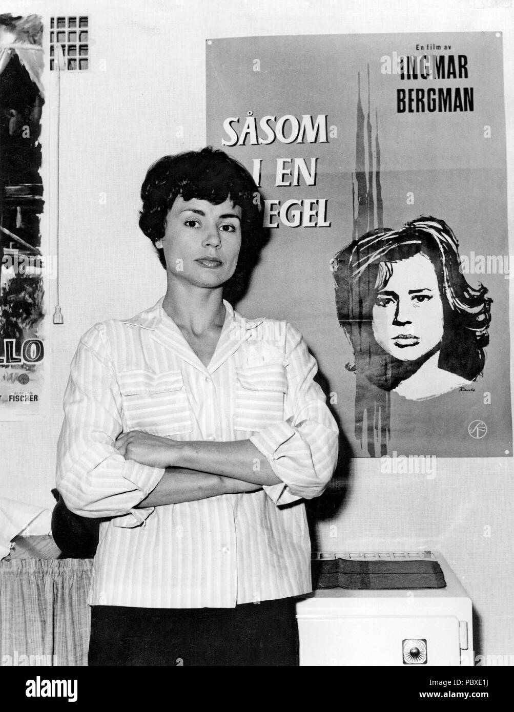 Ingmar Bergman. 1918-2007.  Swedish film director. Here the movie poster for Through a Glass Darkly and actress Harriet Andersson who plays a leading role in the film. 1962 Stock Photo