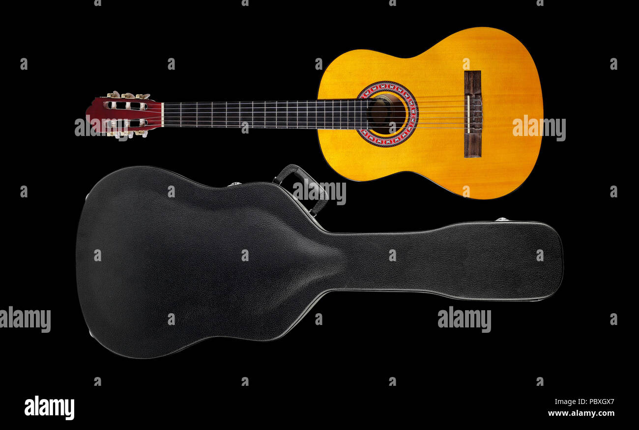 Musical instrument - Acoustic classic guitar hard case isolated on a black background. Stock Photo