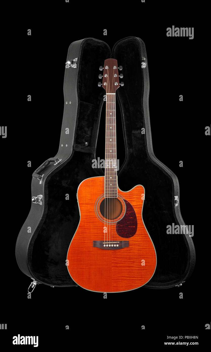 Musical instrument - Front view orange electro acoustic cutaway guitar in hard case  isolated on a black background. Stock Photo