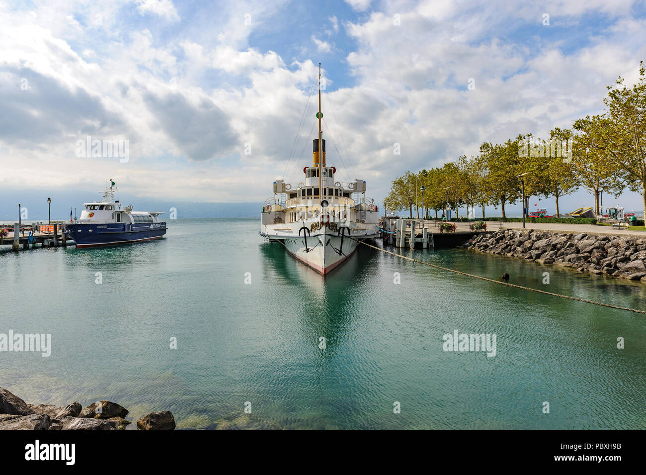 A paddle steamer, a unique and modern restored steamboat as commuter passenger ferry on Lake Geneva, Switzerland Stock Photo