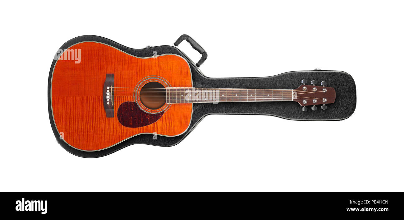 Musical instrument - Orange western guitar from above on a hard case isolated on a white background. Stock Photo