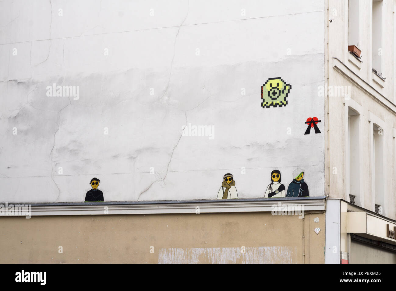 Small stencil graffiti on wall in Paris, France. - Stock Image