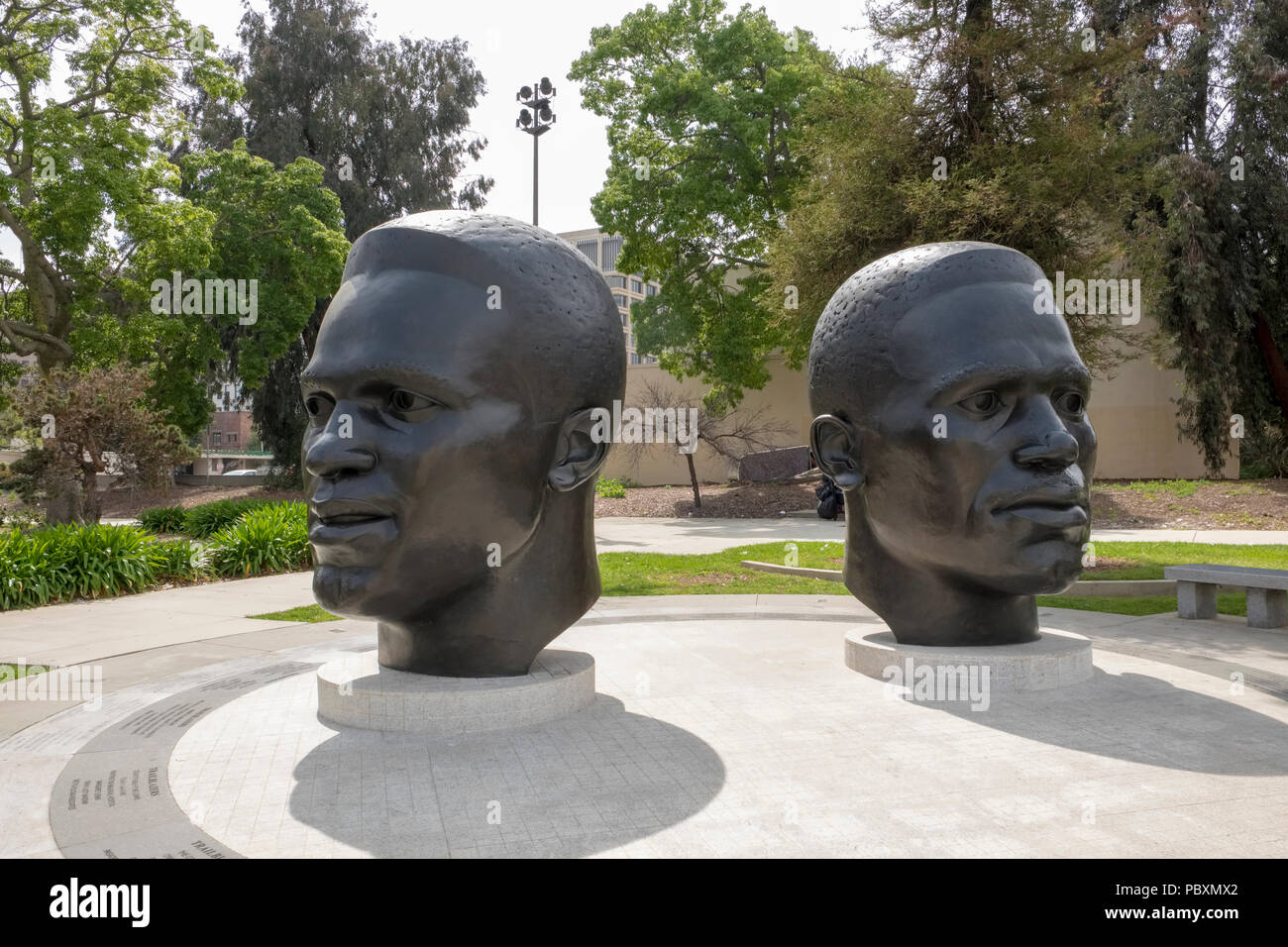 Statues of black Olympic athletes, Mack Robinson and his younger brother Jackie Robinson outside City Hall, Pasadena, California, CA, USA - Stock Image
