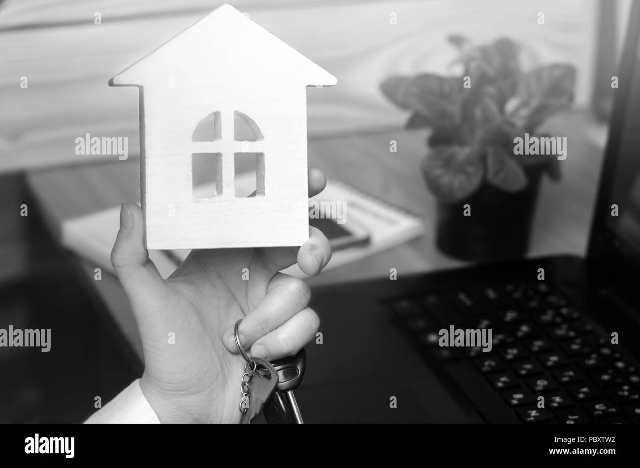 keys and a small house in hands. real estate agent. concept of buying apartments, selling apartments, renting a home. construction, mortgage, property - Stock Image
