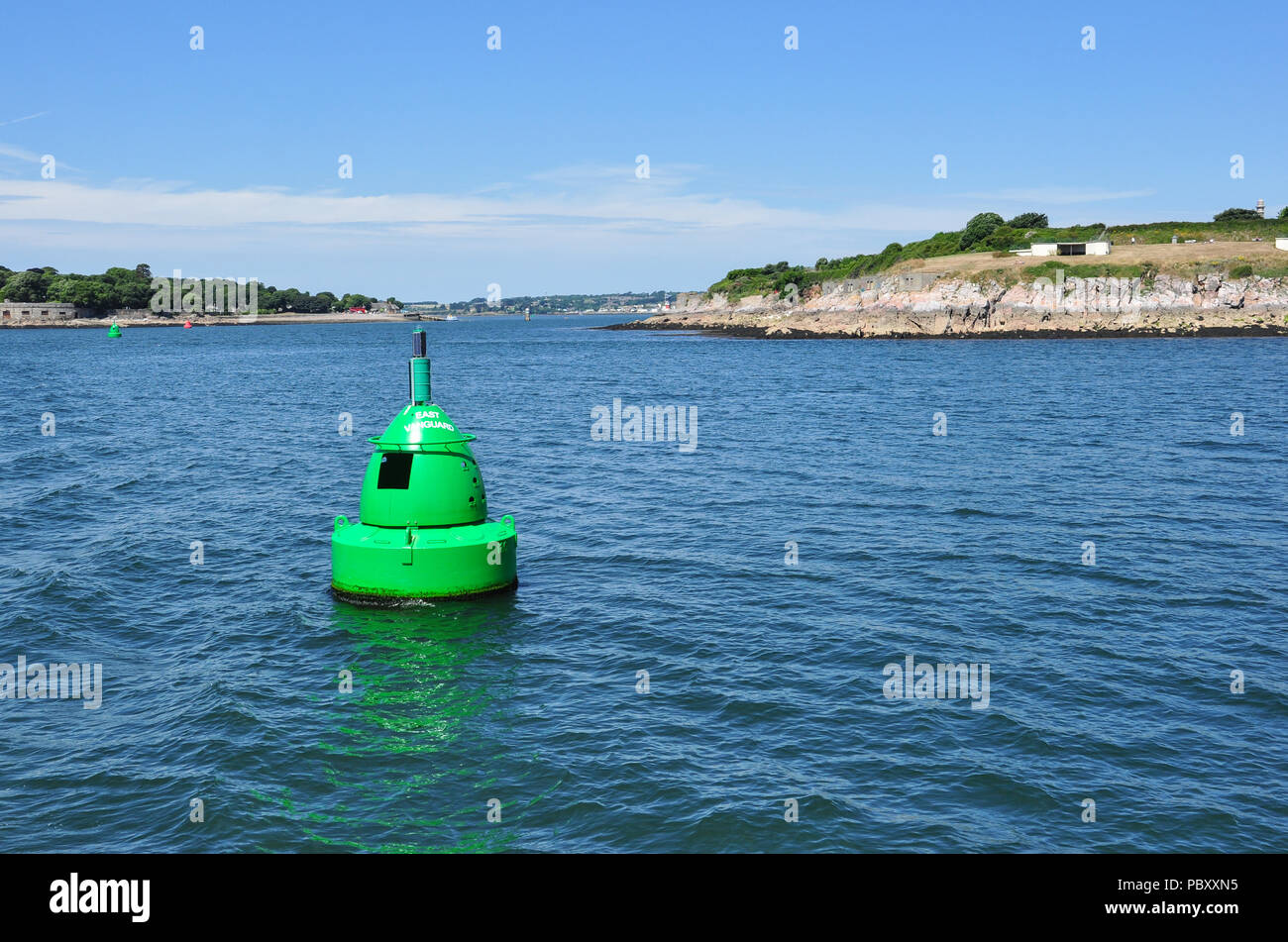 Green marker buoy near Devil's Point at entrance to River Tamar, Plymouth Sound, Devon, England, UK Stock Photo