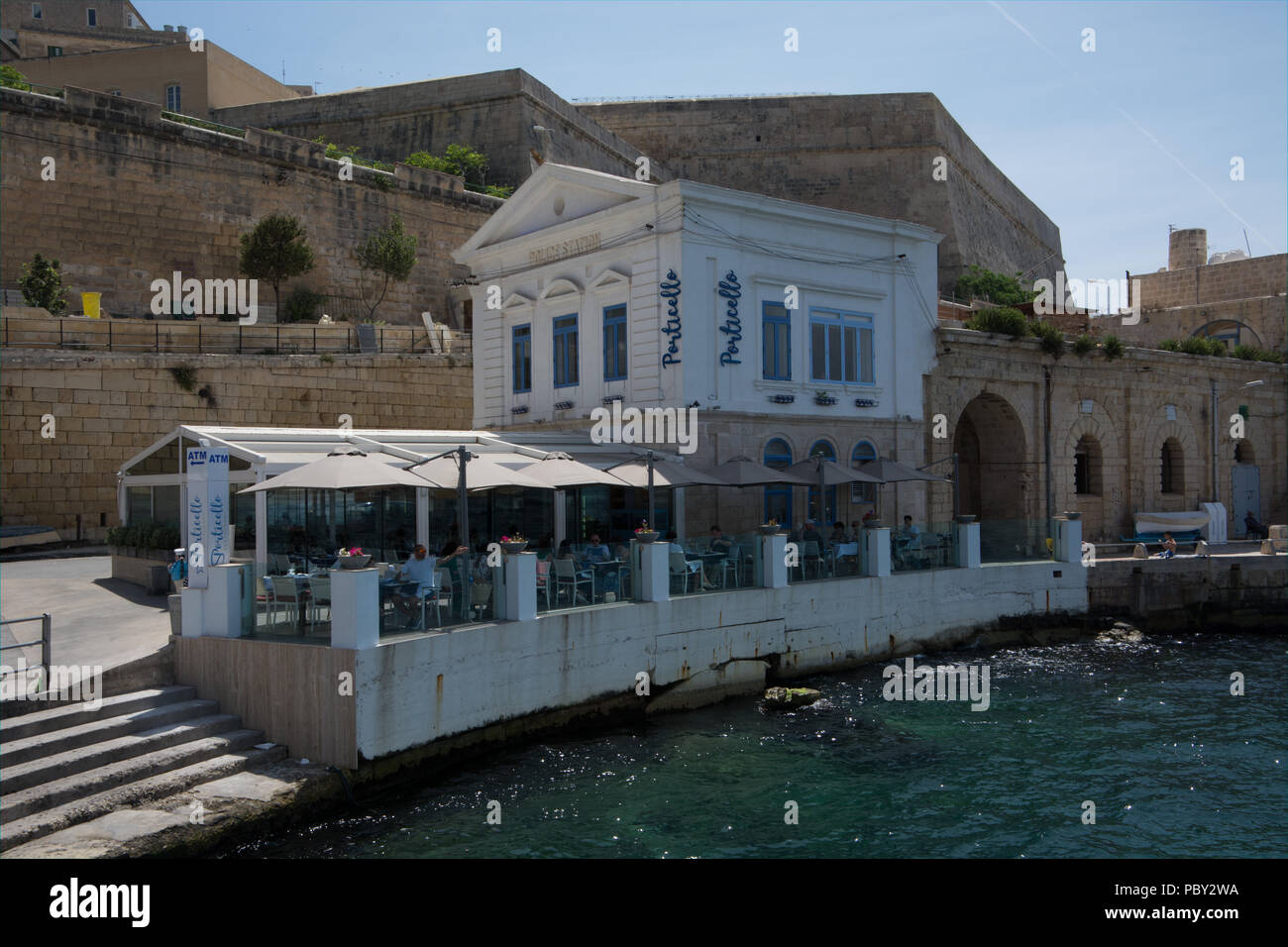 An old police station is now in use as a restaurant by the Valletta dock of the Sliema to Valletta ferry. - Stock Image