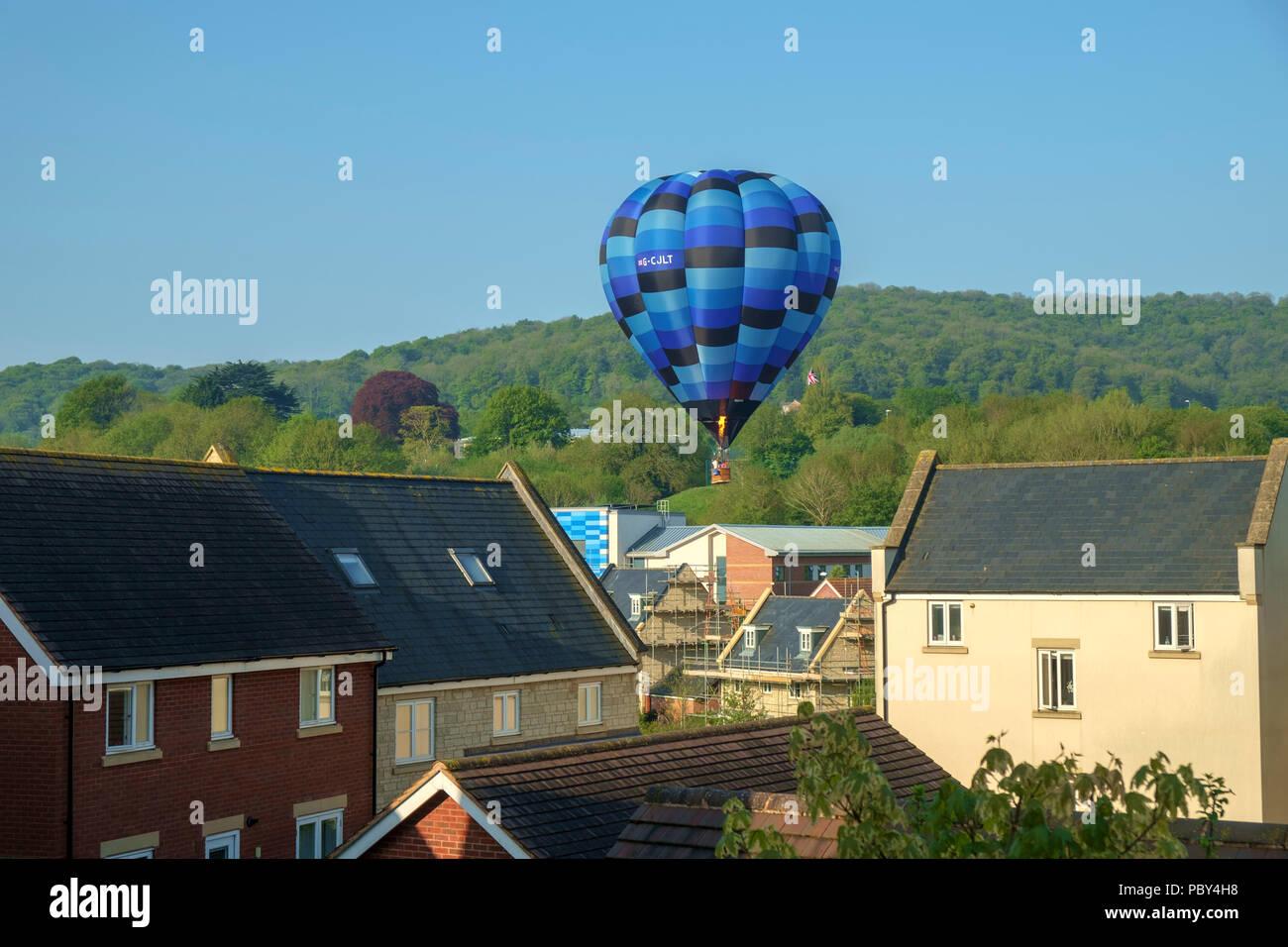 Dursley, Gloucestershire, UK - 7th May 2018: A hot air balloon makes