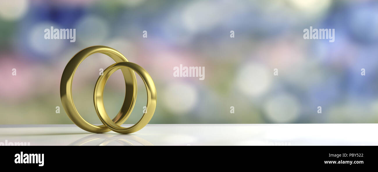 Pair Of Golden Wedding Rings Isolated On White Table Blur
