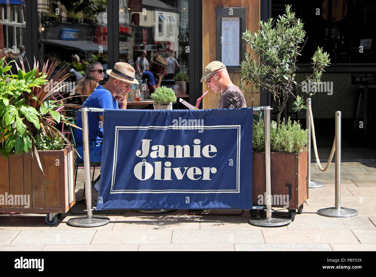 Jamie Oliver restaurant exterior with people sitting eating outside at tables in Cardiff City Centre Wales UK  KATHY DEWITT - Stock Image