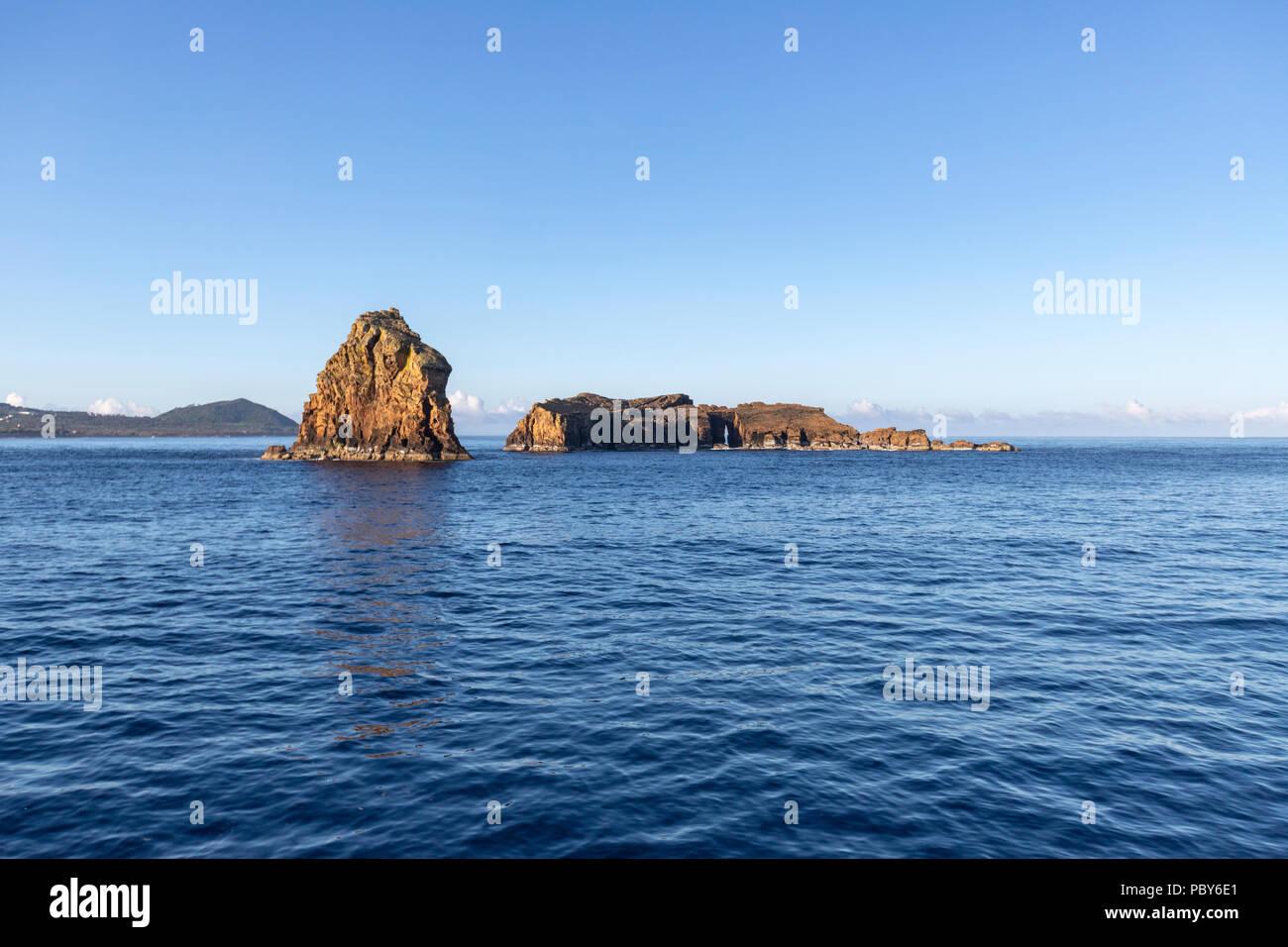 Ilhéus Deitado e Em Pé  in Madalena from the ferry to Horta, Pico Island, Azores, Portugal - Stock Image
