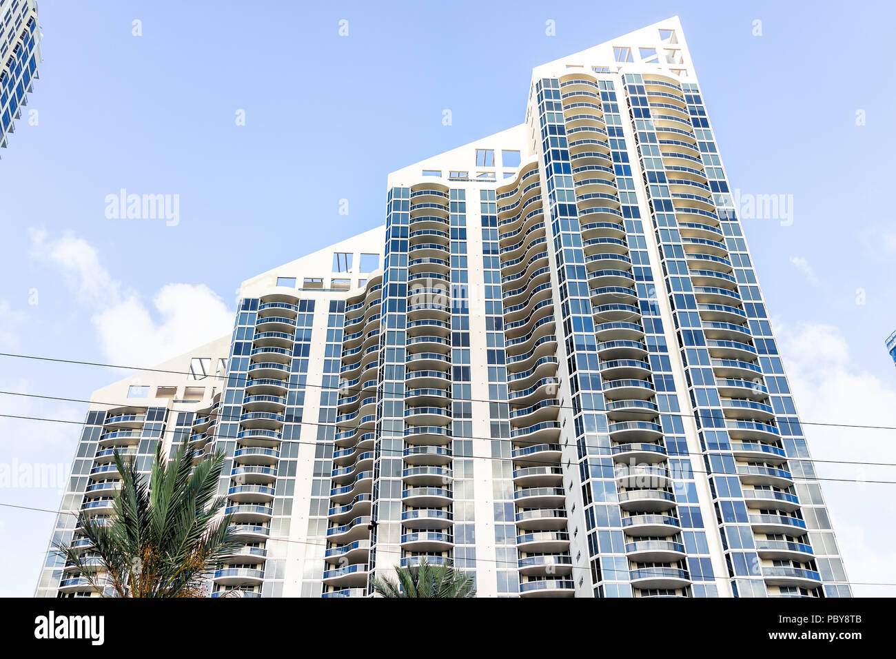 Sunny Isles Beach, USA - May 4, 2018: Apartment condo Pinnacle building balconies during sunny day in Miami, Florida with skyscraper, nobody perspecti - Stock Image
