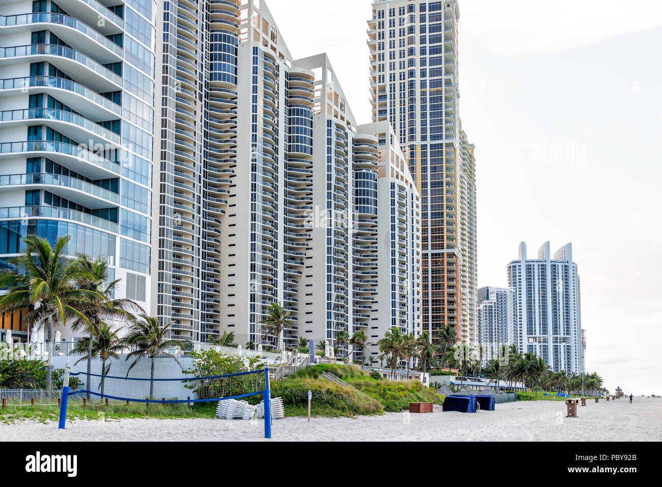 Sunny Isles Beach, USA - May 7, 2018: Apartment condo hotel Pinnacle building balconies during sunny day in Miami, Florida with skyscrapers urban sand - Stock Image