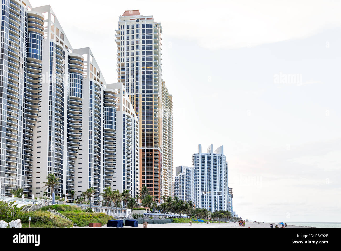 Sunny Isles Beach, USA - May 7, 2018: Apartment condo hotel Pinnacle building balconies during sunny day in Miami, Florida with skyscrapers urban exte - Stock Image
