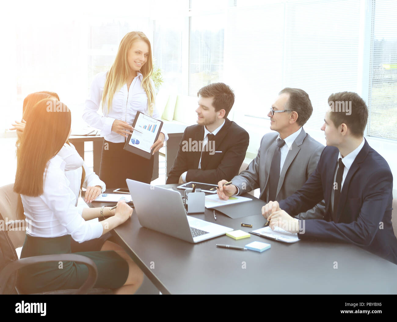 Manager discussing with business team new business plan - Stock Image