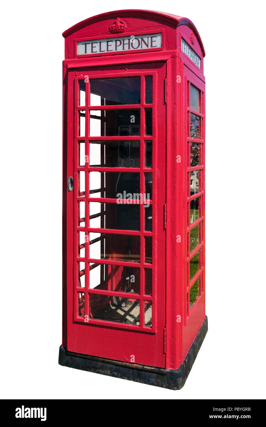 Traditional British red phone box with telephone still in use inside cutout and isolated on a white background. UK Britain - Stock Image