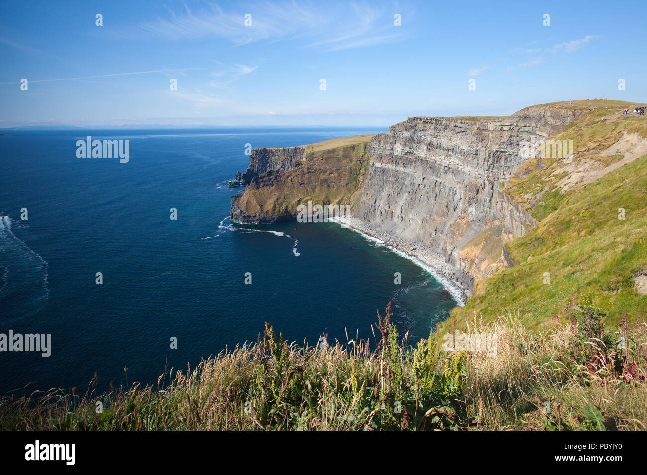 The famous Cliffs of Moher are sea cliffs located at the southwestern edge of the Burren region in County Clare, Ireland. They run for about 14 kilome - Stock Image