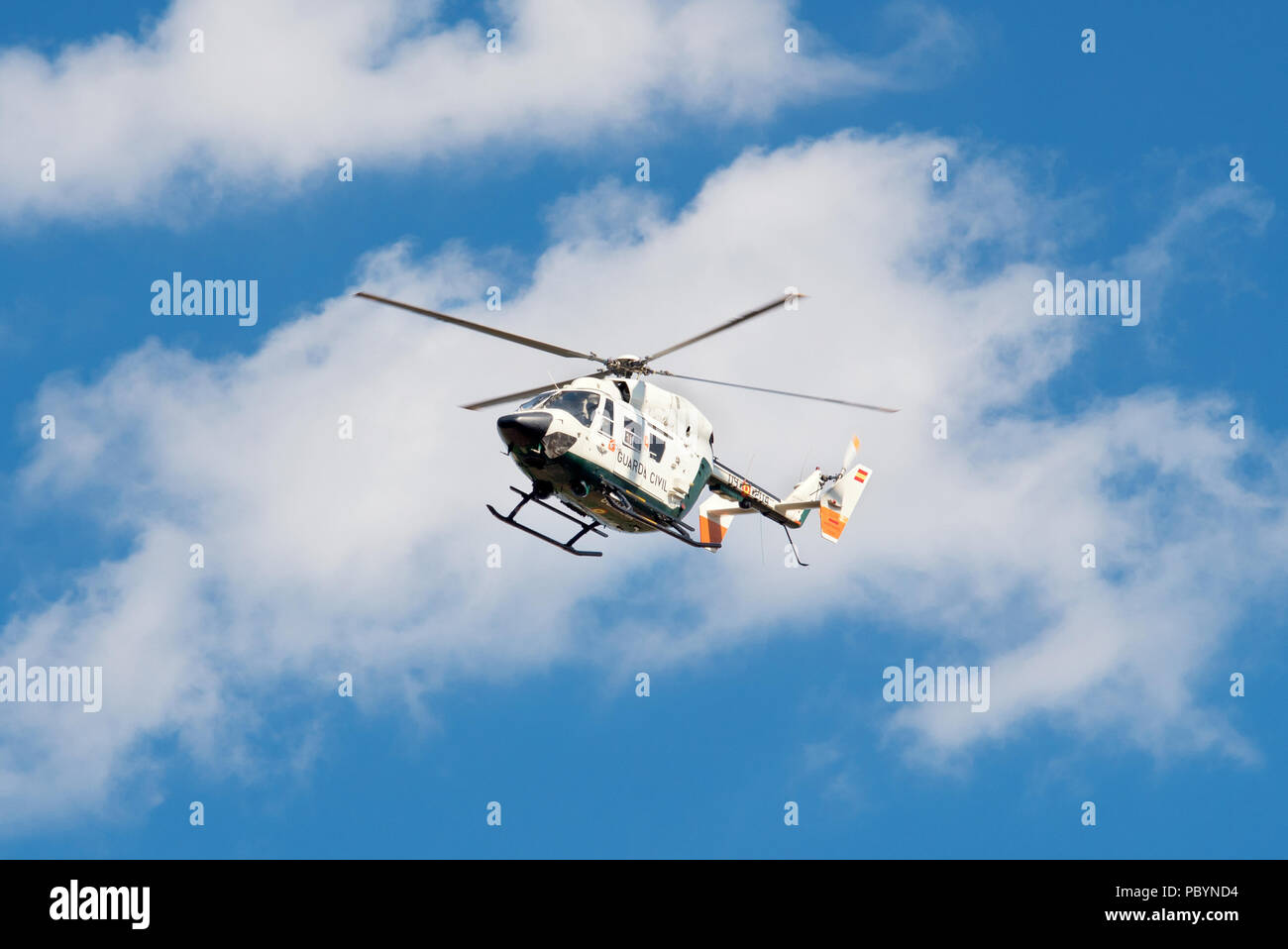 Burgos, Spain - July 23, 2018: Guardia Civil helicopter patrolling the sky. - Stock Image