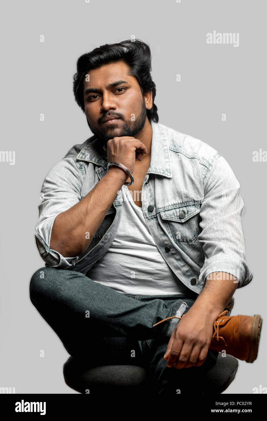 602b180593a indian guy sitting with pensive look. think about life. brutal serious  actor. sporty mman in casual stylish outfit