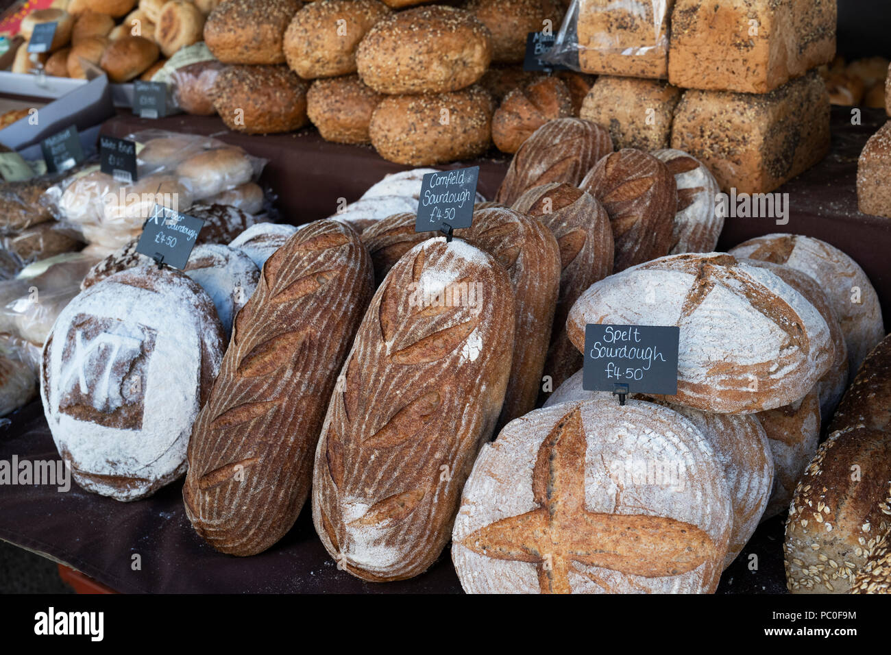 Sourdough bread for sale on a stall at a farmers market. Deddington, Oxfordshire, England - Stock Image